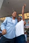 Rapper Ludacris smiles as Ella Me Johnson reacts to being presented with keys to her car at Nissan South, Sunday, Sept. 6, 2009 in Morrow, Ga.. Ludacris, The Ludacris Foundation and Nissan South partnered to give away 20 used vehicles to selected Metro Atlanta area residents as part of his LudaDay weekend. (AP Photo/Paul Abell)