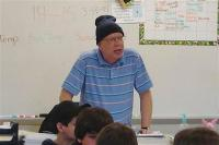In this undated 2008 photo, Bill Sparkman speaks to a 7th grade class during a lesson about sound waves.