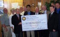 "Bobby Jindal holds a ""check"" sending stimulus dollars to Vernon Parrish in Louisiana."