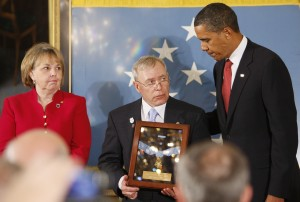 President Barack Obama posthumously awards Army Sgt. 1st. Class Jared C. Monti from Raynham, Mass., the Medal of Honor for his service in Afghanistan, to his parents Paul and Janet Monti, Thursday, Sept. 17, 2009, in the East Room of the White House in Washington. (AP Photo/Charles Dharapak)