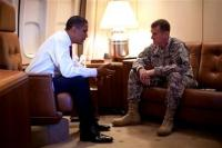 This photo provided by the White House shows President Barack Obama meeting with Gen. Stanley McChrystal, the top commander in Afghanistan, Friday, Oct. 2, 2009, aboard Air Force One in Copenhagen, Denmark.