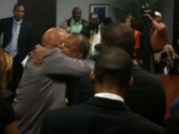 Tom Joyner and Henry Louis Gates (at left) embrace after being granted posthumous pardons for Joyner's great-uncles.