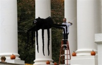 A volunteer decorates the North Portico of the White House