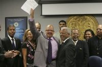 Joyner holds up the signed pardon