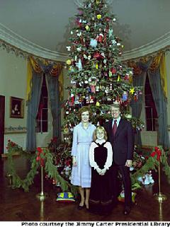President And Mrs. Carter With Daughter Amy In Front Of The White House  Christmas Tree