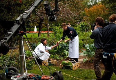 Comerford in the Kitchen Garden during the Iron Chef America filming, harvesting with teammate Flay