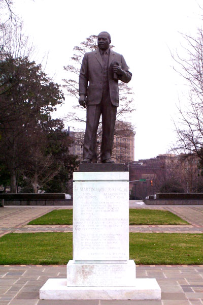 A statue of Dr. Martin Luther King, Jr. looking towards the 16th Street Baptist Church.