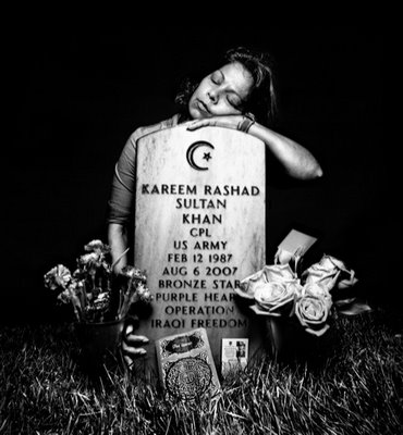 Kareem Rashad Sultan Khan's mother at his grave in Arlington Cemetary