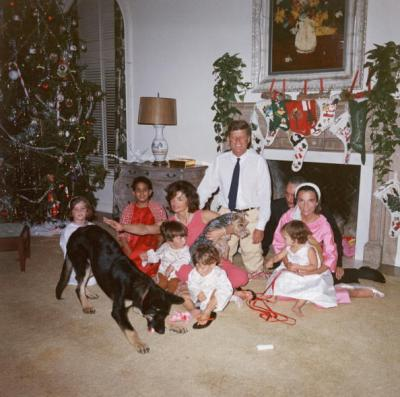 John F. Kennedy and Jacquelyn Kennedy celebrate the season around the Christmas tree with their children Caroline and John Jr., the former First Lady's sister Lee Radziwill, her husband Prince Stanislaus Radziwill and their children Anthony and Ann Christine and two of their furry friends in 1962