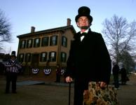 As part of the festivities in Springfield, Ill., a man portraying Abraham Lincoln prepares to lead a candlelight parade from Lincoln's home and to the Old State Capitol.