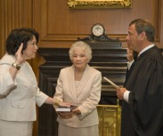 Chief Justice John G. Roberts, administers the Constitutional Oath to Judge Soñia Sotomayor in the Justices' Conference Room on Aug 8, 2009. Mrs. Celina Sotomayor, the mother of the new Associate Justice, holds the family Bible during the ceremony.