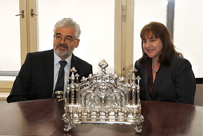 Pavlat and Thompson-Jones during the menorah hand off in Prague