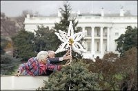 In 1984, First Lady Barbara Bush, assisted by Joseph Riley, president of the Christmas Pageant of Peace committee, placed the top ornament on the national Christmas tree on the Ellipse