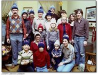 The extended Carter family wears personalized knit hats in this Christmas portrait.