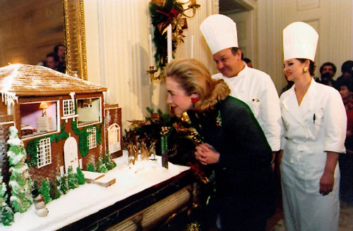 First Lady Hillary Clinton with the White House with the traditional gingerbread house in 1997