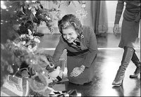 In 1976, First Lady Betty Ford looks over decorations and presents
