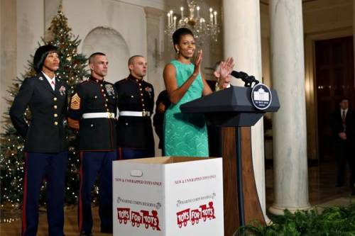 The First Lady debuts the 2009 White House Christmas decorations in the Cross Hall of the White House. She is accompanied by U.S. Marines as she promotes the Marine Corp's Toys for Tots program