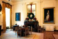 The East Room is decorated with fresh garlands, blue hydrangea, seeded eucalyptus and beaded fruit