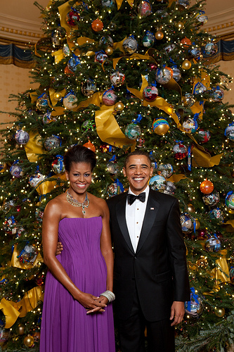 President Barack Obama and First Lady Michelle Obama pose for a formal portrait in front of the official White House Christmas Tree in the Blue Room of the White House, Dec. 6, 2009