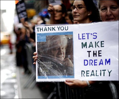 A supporter of health-care legislation holds a portrait of Sen. Edward M. Kennedy at a Times Square rally shortly after Kennedy's funeral.