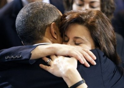 President Barack Obama gets a hug from Victoria Kennedy at a campaign stop for Democratic senate candidate, Massachusetts Attorney General Martha Coakley at Northeastern University in Boston, Sunday, Jan. 17, 2010.(AP Photo/Alex Brandon)