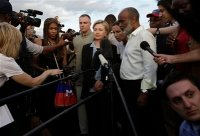 Haiti's President Rene Preval, right, answers questions from the press as U.S. Secretary of State Hillary Rodham Clinton, center, looks on in Port-au-Prince, Haiti, Saturday, Jan. 16, 2010