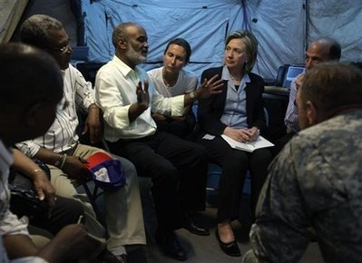 U.S. Secretary of State Hillary Clinton, third from right, meets with Haiti's President Rene Preval, third from left, to discuss conditions in the country