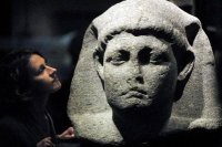 Curator Sally-Ann Ashton admires one of the statues of Cleopatra at the British Museum in London.