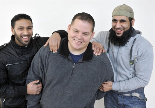 Brandon Neely, center, was a Guantánamo Bay guard, and Ruhal Ahmed, left, and Shafiq Rasul were prisoners.