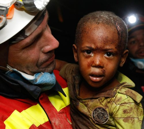 A little boy named Redjeson Hausteen Claude, was saved by a Spanish emergency worker whose team have managed to reach the afflicted area.