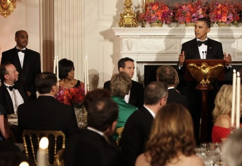 U.S. President Barack Obama speaks next to Minnesota Governor Tim Pawlenty (C) and first lady Michelle Obama (L) at the 2010 Governors Ball at the White House in Washington February 21, 2010.