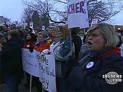 Teachers are rallying for their jobs, anticipating the vote for a mass firing.  (CBS)