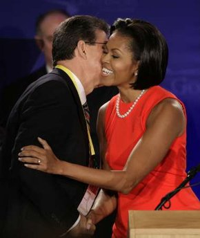 First Lady Michelle Obama is greeted by West Virginia Governor Joe Manchin III, as she is introduced to speak at the National Governors Association Winter Meeting in Washington Saturday, Feb. 20, 2010. (AP Photo/Cliff Owen)