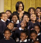 U.S. first lady Michelle Obama poses for a group photo with music students from Myrtilla Miner elementary school at the White House in Washington February 21, 2010.